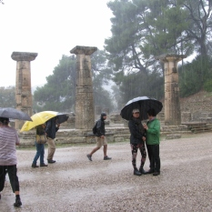 Rain Pouring on Ruins & People